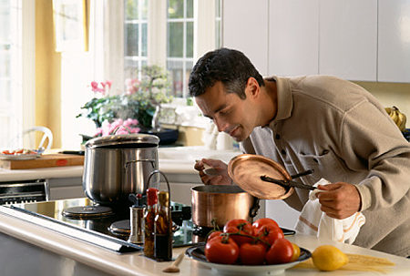 Man Cooking, Smelling Aroma Original Filename: 200357416 001 Design