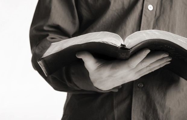 man-holding-bible